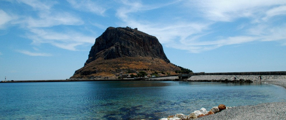 <h1>The Rock</h1><h3>Monemvasia means single entrance, and as you cross the narrow bridge linking the fortified rock to the mainland, you can see why.</h3>